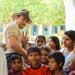 Expedition leader Brandon with children at a school clinic.